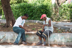Senior Cuban citizens playing chess in the street Stock Images