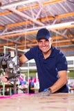 Senior cutting fabric Stock Images