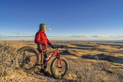 Sunset over prairie with fat bike Royalty Free Stock Photos