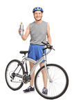 Senior cyclist holding a water bottle Royalty Free Stock Photo