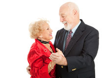 Senior Dance. Loving seniors couple out dancing together.  Isolated on white background Royalty Free Stock Images