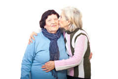 Senior daughter kissing elderly mother Stock Image