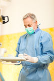 Senior dentist at workin studio Stock Photo