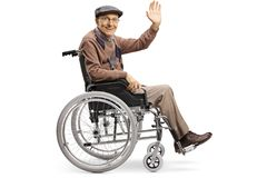 Senior disabled man waving from a wheelchair. Full length shot of a senior disabled man waving from a wheelchair isolated on white background stock photography