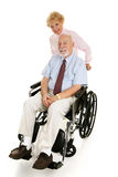 Senior Disabled Man & Wife Stock Images