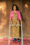 Senior disabled woman with walker Royalty Free Stock Image