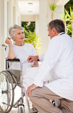 Senior doctor. Talking with his patient Stock Image