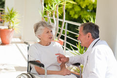 Senior doctor. Talking with his patient Royalty Free Stock Image