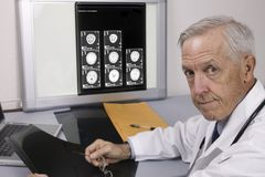 Senior doctor. With MRI in office Stock Images