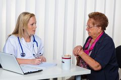 The senior doctor. An elderly lady at the doctor in practice. consultation with the doctor Stock Image