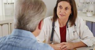 Senior doctor advising elderly patient Royalty Free Stock Photo