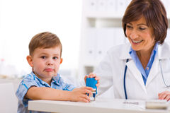 Senior doctor and boy Stock Images