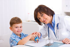 Senior doctor and boy Stock Image
