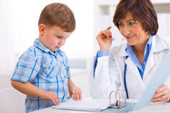 Senior doctor and boy Royalty Free Stock Image