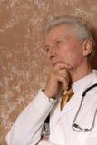 Senior doctor on brown Royalty Free Stock Photo