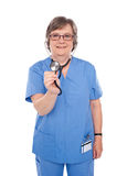 Senior doctor checking your heartbeats. Aged female specialist checking your heartbeats isolated over white background Stock Images