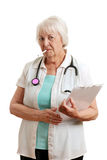 Senior doctor with a cigarette in her mouth Royalty Free Stock Images