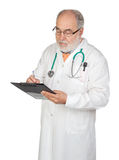 Senior doctor with clipboard Stock Images