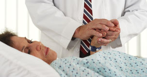 Senior doctor comforting elderly patient Royalty Free Stock Photos