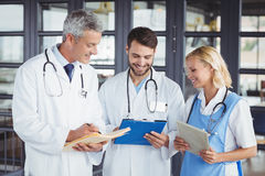 Senior doctor discussing with coworkers Stock Images