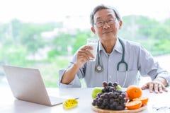 Senior doctor drink milk advisor eating healthy food royalty free stock photo