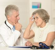 Senior doctor with elderly patient Stock Images