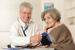 Senior doctor with elderly patient Stock Photography