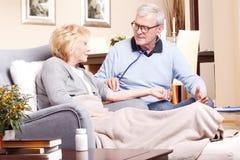 Senior doctor and elderly patient stock image