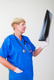 Senior doctor examining x-ray Stock Image