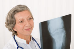 Senior doctor female happy hold x-ray Royalty Free Stock Photo