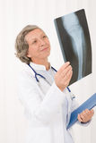 Senior doctor female happy hold x-ray Stock Photo