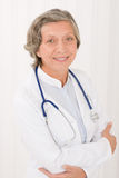 Senior doctor female with stethoscope smiling Royalty Free Stock Photo