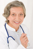 Senior doctor female with stethoscope smiling stock photography