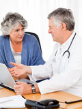 A senior doctor with his patient Stock Images