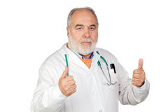 Senior doctor with hoary hair saying Ok Royalty Free Stock Photos
