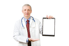 Senior doctor holding blank sheet of paper Stock Image