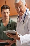 Senior Doctor Holding Clipboard Stock Photography