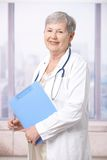 Senior doctor holding notepad Royalty Free Stock Images