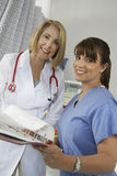Senior Doctor And Nurse In Hospital Royalty Free Stock Photography