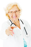 Senior Doctor Offering Handshake Over White Background Stock Images