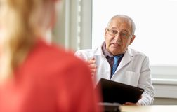 Senior doctor and patient at womens health clinic Stock Photos