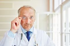 Senior doctor or physician. As competent and successful surgeon royalty free stock image