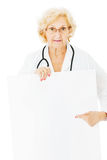 Senior Doctor Pointing At Blank Billboard Stock Photos