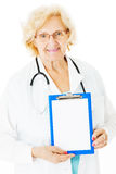 Senior Doctor Showing Clipboard With Blank Paper Stock Photo