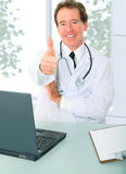 Senior Doctor Sit In His Office Stock Photo