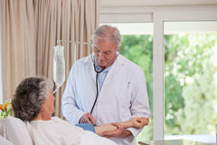 Senior doctor sounding his patient Royalty Free Stock Images