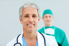 Senior Doctor standing in front of his team Stock Photo