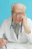 Senior doctor with stethoscope stock photography