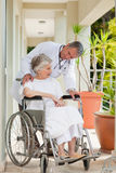 Senior doctor talking. With his patient Stock Photo