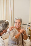 Senior doctor talking with his patient Stock Photography